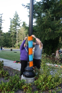 Gwen and her hubby working on installing another piece on a lamp post.