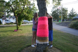 My daughter, Faith, and hubby, Evan, attaching a yarnbomb to a tree in the park.