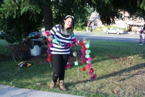 Jade with her pom-pom string ready to decorate a tree for the instillation.
