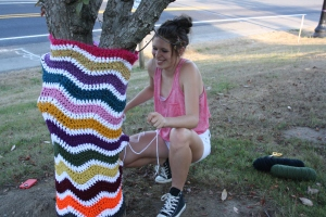 My daughter, Emma, helping with installing a yarnbomb at the park.