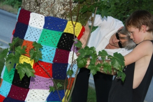 My mother-in-law, Tracey, and my son, Rubin, putting up a funky granny square piece.