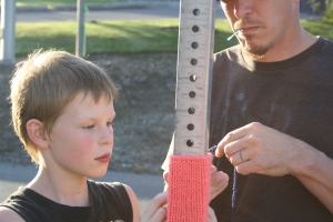 Crafty men in my life lending a hand with the yarnbomb install. Rubin and dad, Evan.